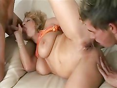 Two boys pick up mature