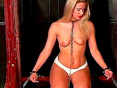 Chained and collared girl in dungeon