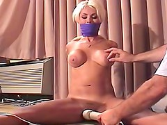 Gagged and tied girl with big tits