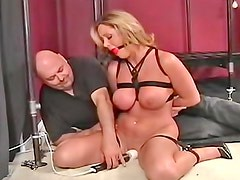 Cute blonde with gag in her mouth is feeling herself satisfied