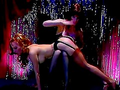 Slutty brunette with big tits is punishing her slutty maid on the chair