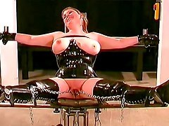Tight latex makes BDSM video sexier