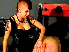 Mistress with mohawk ties up sub guy