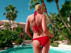 Pretty blonde in red bikini fingers herself by the pool