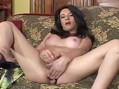 Brunette tranny Tosha rubs her cock till it explodes with cum