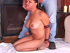 Hot wax glazes her big tits in BDSM