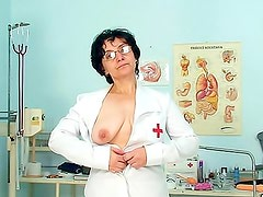 Mature nurse in glasses toys pussy