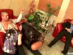 Clothed ladies suck cock at party
