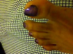 Foot tease- Purple toes and slender soles