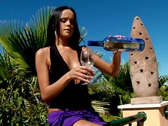 Sizzling brunette masturbates outdoors after drinking wine