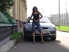 Perverted russian chick pissing onto the stranger's car