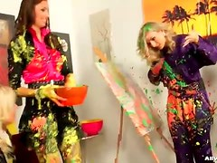 Clothed women make a mess with paint