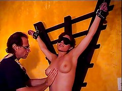Big tits hottie Audrey ends up with hot wax over her tits in a BDSM session