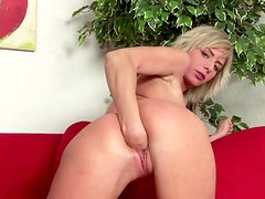Salacious blonde fingers her pussy before fisting it