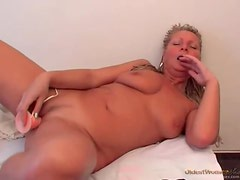 Close up on pretty mature pussy toying solo