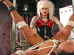 Kinky latex mistress abuses a guy