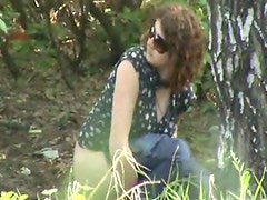 Voyeur pissing outdoors with glasses girl