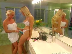 Blonde Lesbians Eating Pussy In The Bathroom