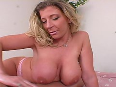 Horny Blonde Chick Playing With Her Big Tits