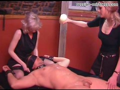 Hot wax dripped over bound submissive
