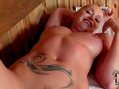Blonde sucks cock in the sauna
