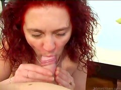 Mature redhead sucks dick sensually