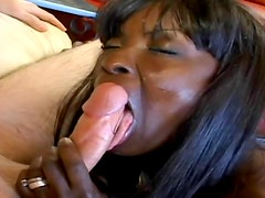 Black chick sucks on a long hard white cock