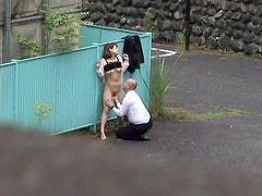 Japanese couple gets caught on a voyeur's cam while fucking in the street