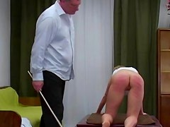 Ass caned hard by her dominant master