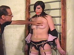 Blindfolded and bound girl with chest tattoo