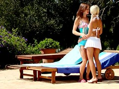 Climaxing Cuties give pleasure to each other on the deckchair