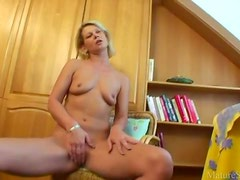 Cute naked milf gives pussy joy with toy