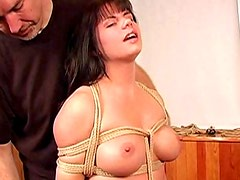 Tied up busty girl is caned across the ass