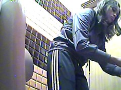 Chick in sporty pants spycam pissing