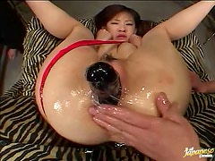 Japanese whore takes all kinds of toys in her extremely oiled holes