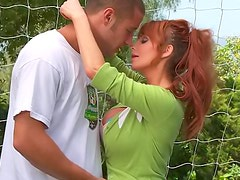 Redhead soccer mom fucked on the field