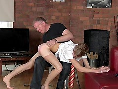 Old guy spanks twink on the ass