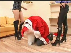 Chicks in boots abuse guy in Santa costume
