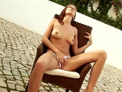 A Pretty Girl Gets Naked & Toys With a Cock-Shaped Toy