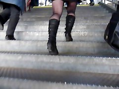 Following sexy girl wearing Black Skirt, Boots & Stockings