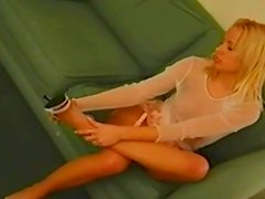 Beauty puts on her stockings and attaches garters