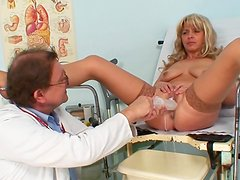 Mature vagina examined by a doctor