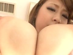 Hitomi Kitagawa gives a titjob and makes the cock explode with cum