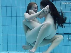 Cute girls fool around naked in the pool