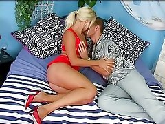 Blonde whore in red lingerie sucks on a long cock