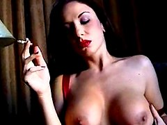 Smoker in red lipstick has big sexy tits