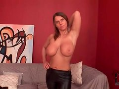 Busty chick shows off her tight leather pants
