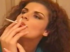Sexy brunette smoking and undressing