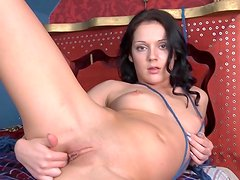 Irena lying on the bed and masturbating her vag