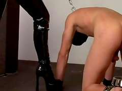Masked victim spanked by domina